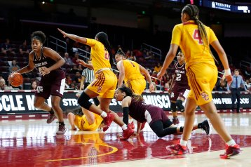 Texas A&M retains possession after a loose ball scramble. Maria Noble/WomensHoopsWorld