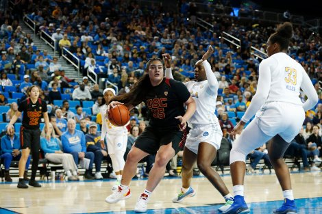 Alissa Pili drives into the paint. Maria Noble/WomensHoopsWorld