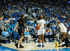 Charisma Osborne is surprised to be called for the foul. Maria Noble/WomensHoopsWorld