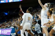 The Bruins celebrate a three-point shot. Maria Noble/WomensHoopsWorld