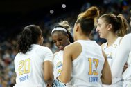 The Bruins converge at a timeout. Maria Noble/WomensHoopsWorld