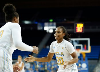 Lauryn Miller and Charisma Osborne celebrate a bucket. Maria Noble/WomensHoopsWorld