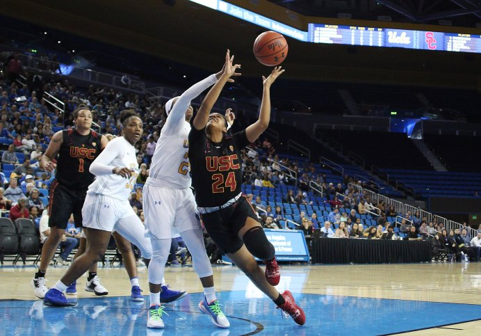 Japreece Dean bats the ball away from Desiree Caldwell. Maria Noble/WomensHoopsWorld
