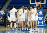 The Bruins huddle before they leave the court. Maria Noble/WomensHoopsWorld.