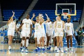 The UCLA team waves the crowd as they walk off the court. Maria Noble/WomensHoopsWorld.
