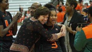Hurricanes coach Katie Meier hugs Destiny Harden. Photo courtesy of Miami Athletics.