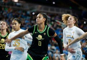 Satou Sabally boxes out UCLA players. Maria Noble/WomensHoopsWorld.