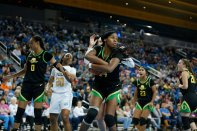 Ruthy Hebard holds the ball after a rebound. Maria Noble/WomensHoopsWorld.