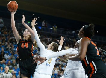 Taylor Jones powers through the UCLA defense for a layup. Maria Noble/WomensHoopsWorld.
