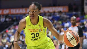 Azura' Stevens brings the ball up court during her rookie season. Layne Murdoch/NBAE via Getty Images.