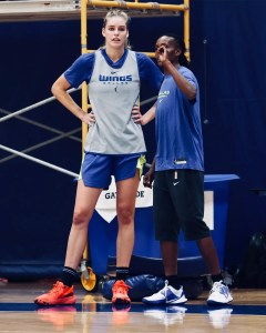 Bella Alarie gets instruction from assistant coach Crystal Robinson. Photo courtesy of Dallas Wings.