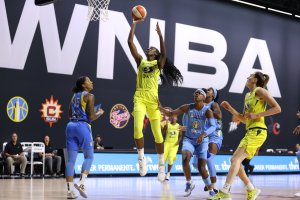 Ezi Magbegor flies over the Sky defense to lay the ball up and in. NBAE/Getty Images photo.