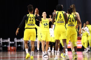 Sue Bird high fives her Seattle Storm teammates during their game against the Minnesota Lynx Tuesday. Photo by Ned Dishman/NBAE via Getty Images.