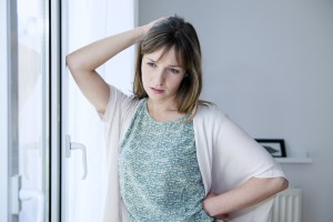 woman worried about period symptoms