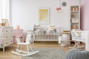 Baby room in scandinavian style with rocking horse