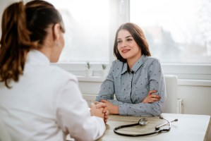 woman and doctor talking during consultation