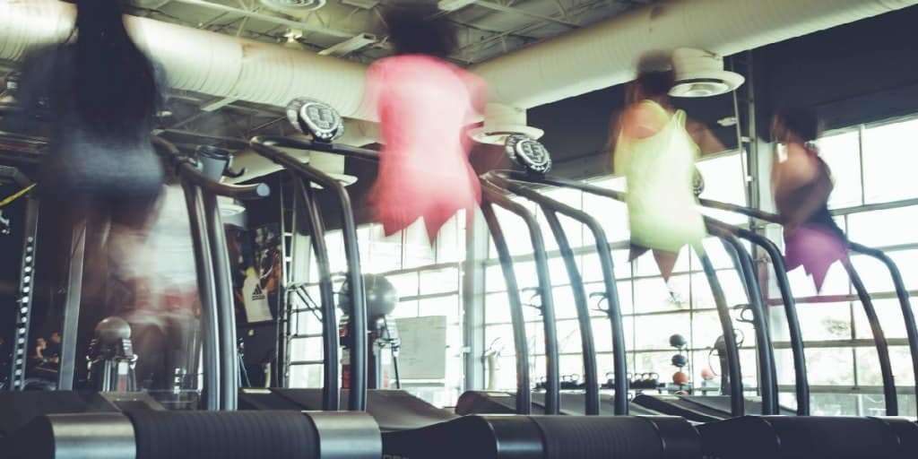 4 women running on treadmills at the ymca