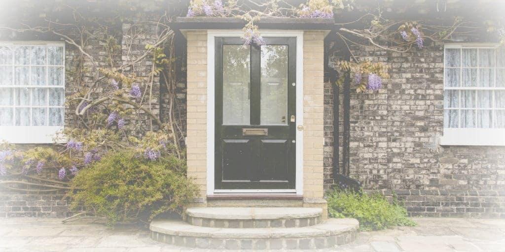 black front door on a brick home