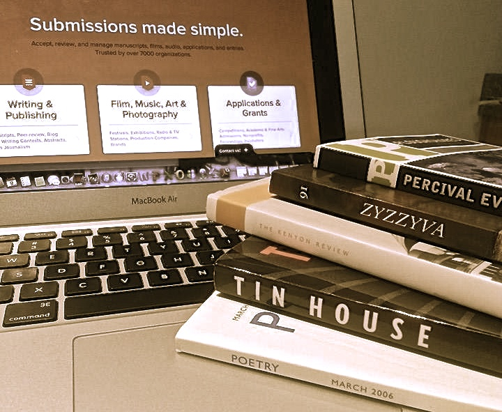 "A laptop computer with an article titled ""Submissions Made Simple"" on the screen and a stack of literary journals sits on top of the laptop base, titles facing out"