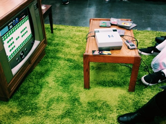 Rose City Comic Con Retro Gaming Area (a TV with a small table and a green rug) 2015: Legend of Zelda (photo by Amanda Vail)