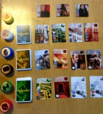 An image of the cards and chips in Splendor, Space Cowboys, 2014.