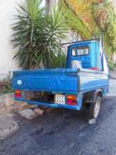 Bolsena 23 - Piaggio-Transporter am Berg