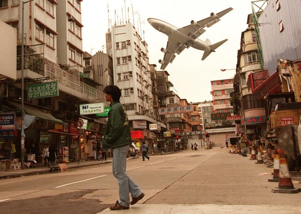 747 on approach to Kai Tak International airport in Hong Kong.
