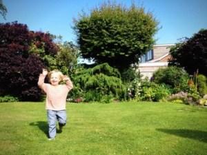 kid playing in garden