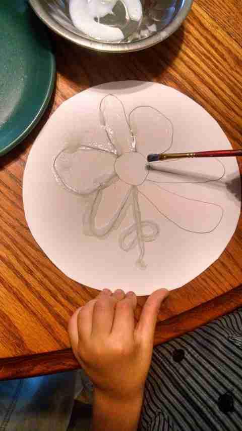 Applying glue to salt painting