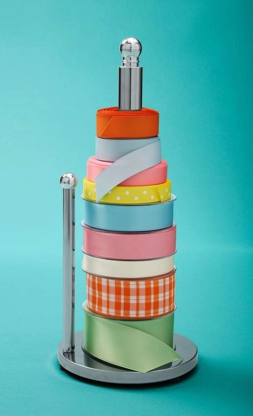 28. Paper Towel Holder Ribbon Organizer