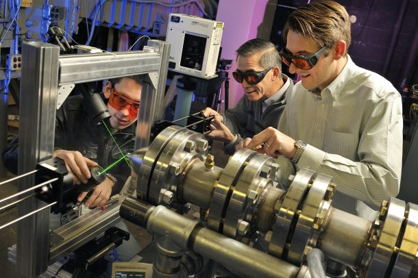 Department of Aerospace and Ocean Engineering, Randolph Hall. Study on jet engine noises and how to reduce the noise blast volume be. Pictured, Tobias Ecker, Wing Ng and Todd Lowe.