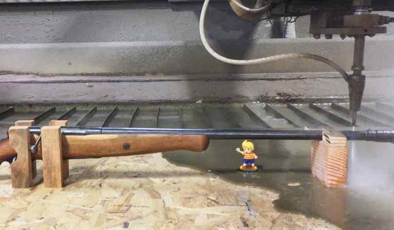 Watch This 60,000 PSI Waterjet Slice A Shotgun In Half