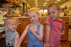 Garrett, Elijah and Toby showing off their tats