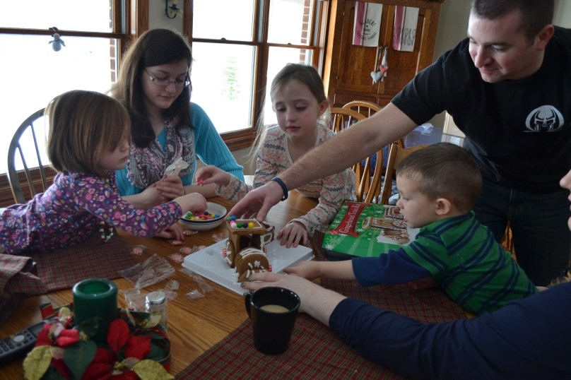 Norah, Aunt Emily, Katie, Mr. H, Garrett and Aunt Susannah working on the gingerbread train