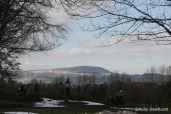 Pendle Hill with the golf players in the for ground, townley golf club, Burnley