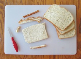 Technically you can leave the crust on, but cutting away excess bread ensures a better ratio of bread to filling.