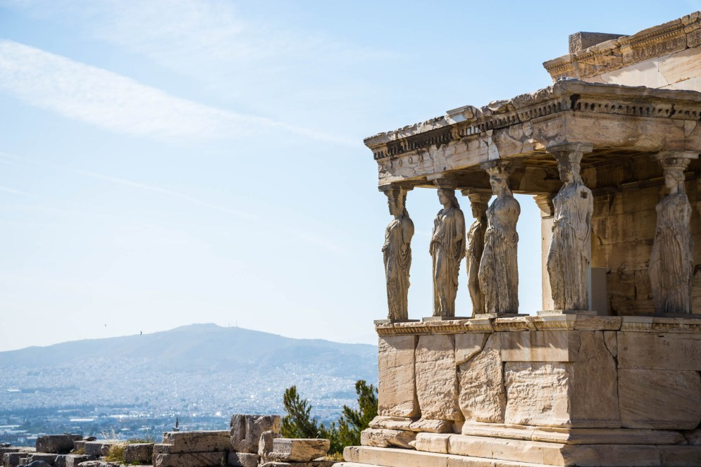 6 Marble statues are used as supporting columns for an ancient greek building. Known as The Caryatids Porch of the Erechtheion, they sit on top of the Acropolis overlooking the city of Athens.
