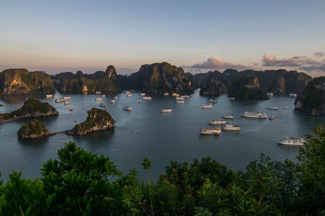 Many Cruise boats set their anchors as the sun sets in Vietnam's Ha Long Bay. Seen from the top of Ti Top Island.