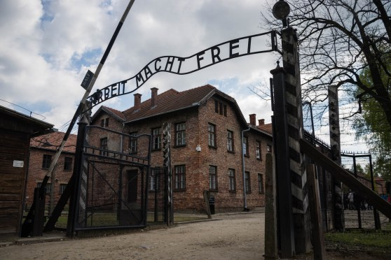 "The gates leading to the Nazi concentration camp known as Auschwitz are seen with its infamous welcoming sign ""Arbeit macht frei"" which translates to ""Work makes you free""."