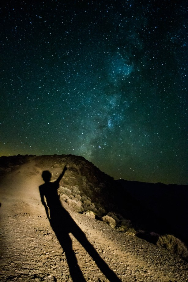 Shadow Sillhouette Pointing to the milky way galaxy in Death Valley
