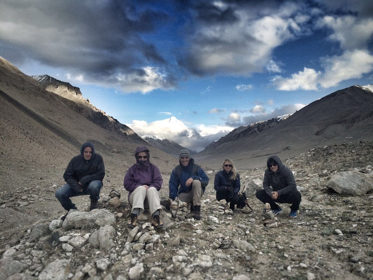 Group in the mountains with the Everest on the background