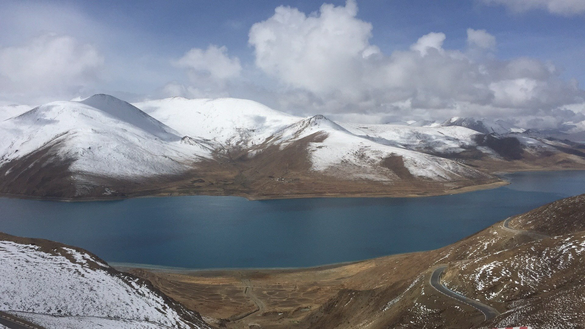 Yamdrok Lake with snow mountains