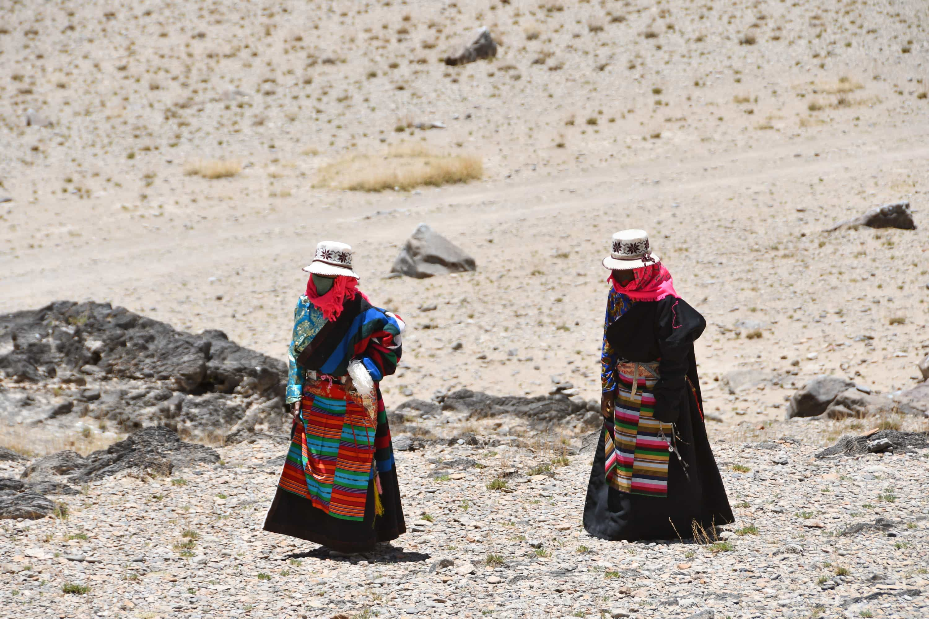 Tibetan women walking sacred kora around Namtso lake in Tibet