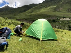 Setting up a tent during the trekking tour in Tibet