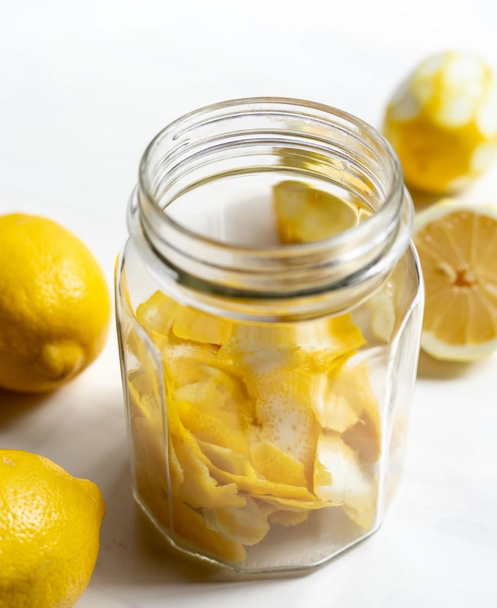 lemon peels in clear glass jar