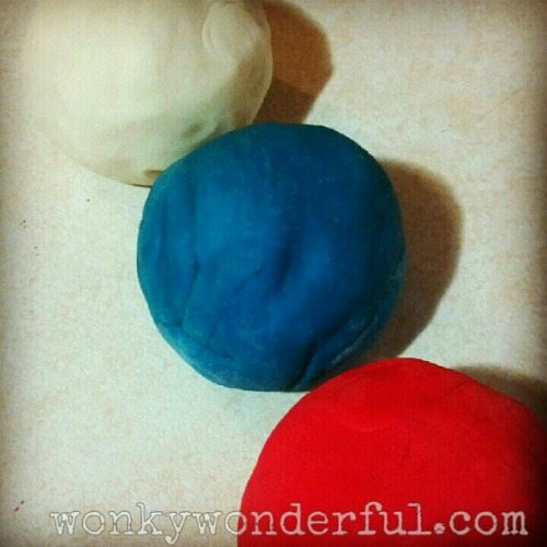 red white and blue play dough balls in a row