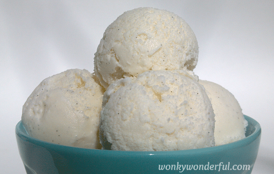 scoops of vanilla ice cream in light blue bowl