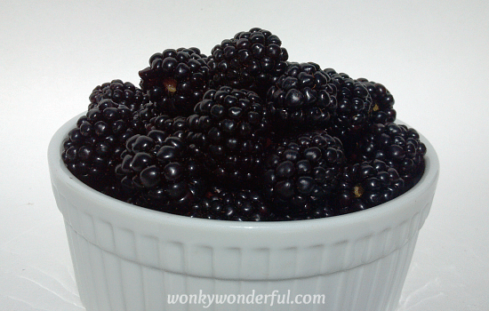 white ramekin filled with fresh blackberries