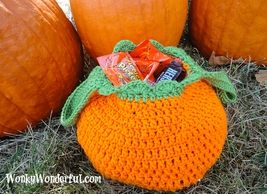 crocheted trick or treat bag filled with candy