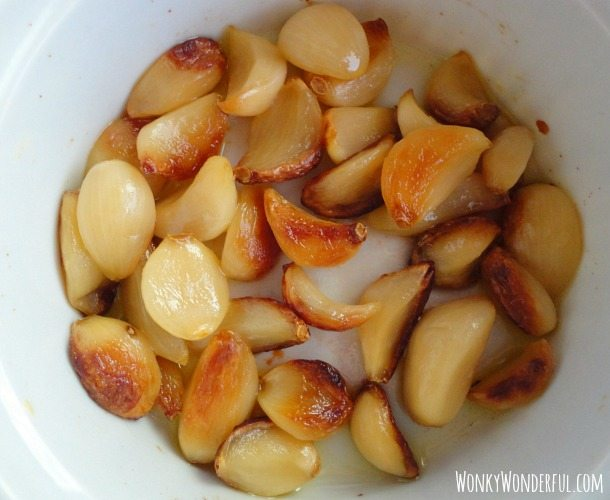 roasted garlic cloves in white dish